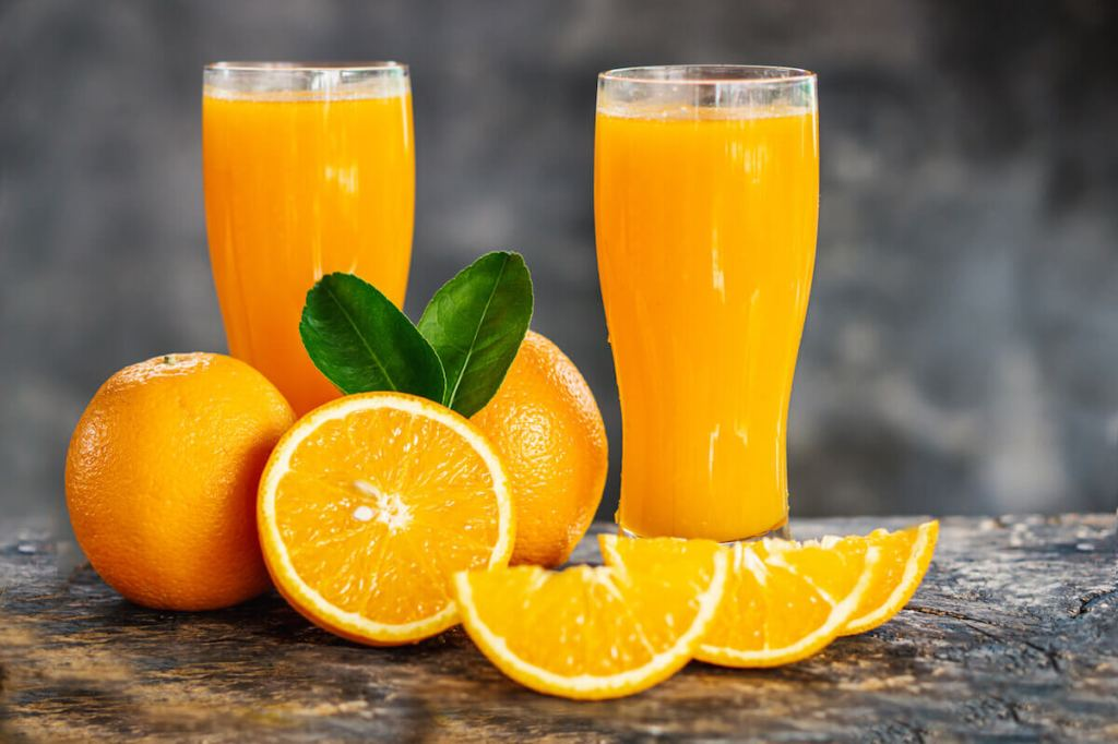 oranges and orange juice in glasses